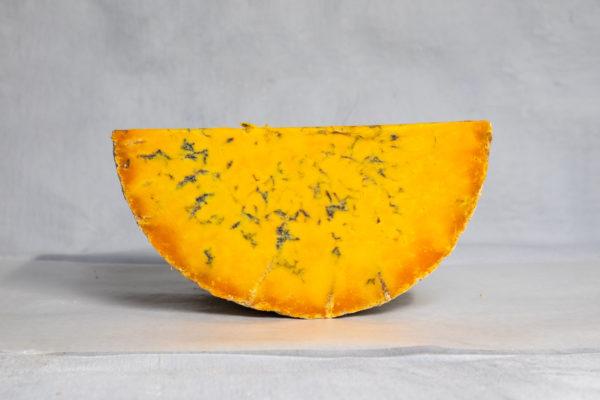 Blue Wensleydale cheese half moon shot bright orange