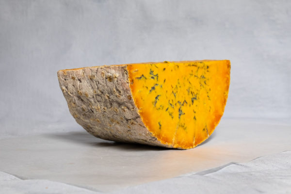 side on picture of a half moon of blue wensleydale cheese