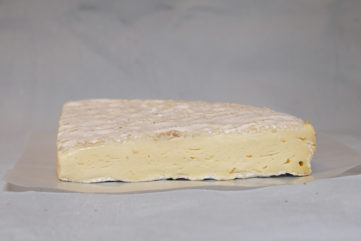 a cross section of brie de meaux cheese