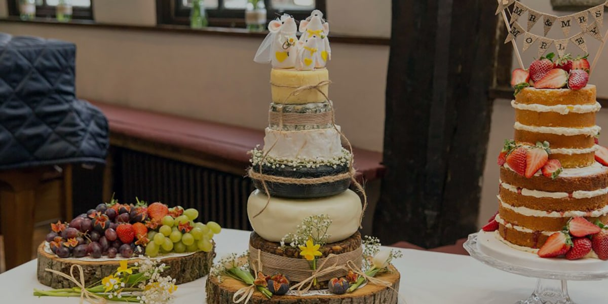 a tower of cheese prepared for a wedding
